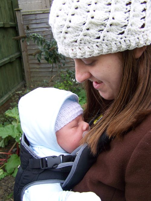Baby carried by his Mum in a baby carrier