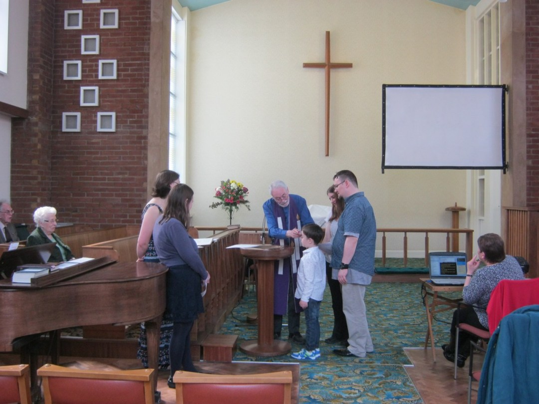 Little Man being Baptised