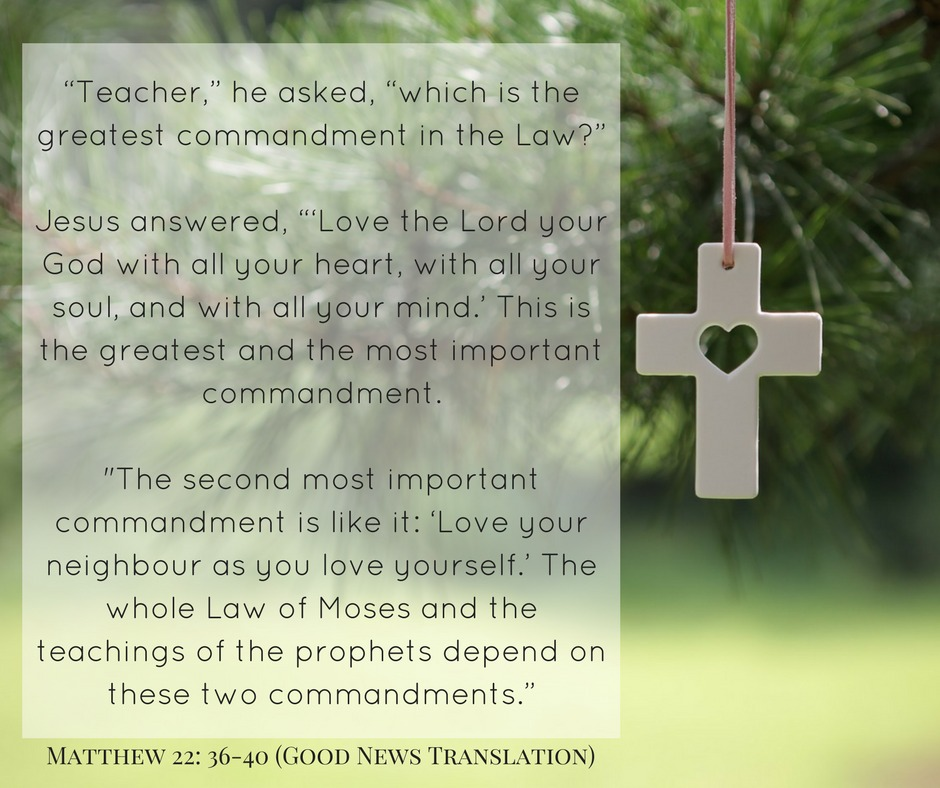 "Image of small cross with heart Christmas tree decoration and the Bible verse Matthew 22:36-40 ""Teacher,"" he asked, ""which is the greatest commandment in the Law?"" Jesus answered, ""'Love the Lord your God with all your heart, with all your soul, and with all your mind.' This is the greatest and the most important commandment. ""The second most important commandment is like it: 'Love your neighbour as you love yourself.' The whole Law of Moses and the teachings of the prophets depend on these two commandments."""