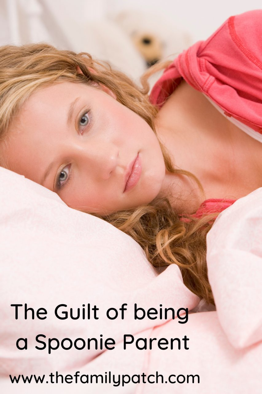 "a blonde haired woman laying in bed, looking sad, with the words ""The Guilt of being a Spoonie Parent"" written over the pillow."