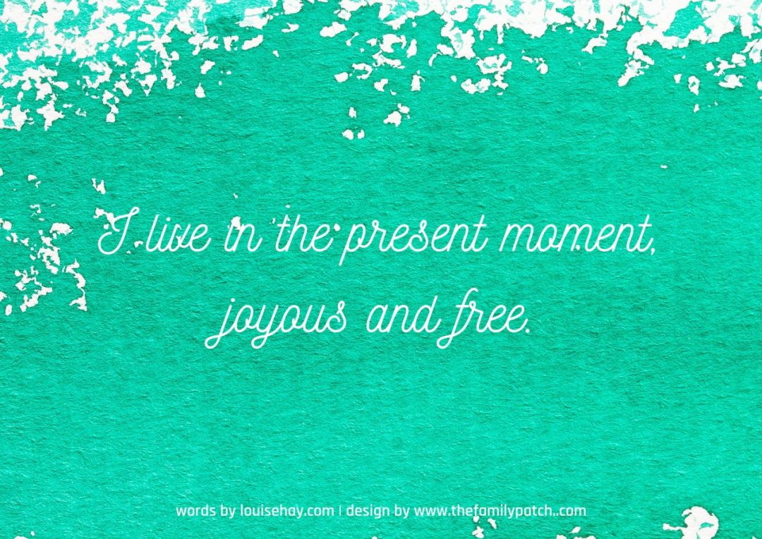 "green watercolour background with affirmation in white text, ""I live in the present moment, joyous and free""."