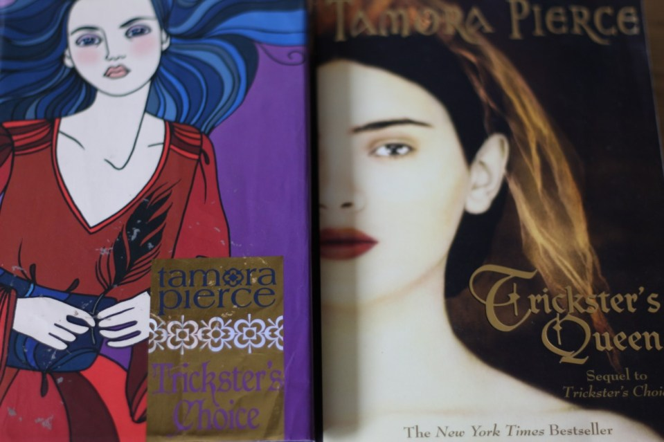 Two Tamora Pierce books side by side, Trickster's Choice and Trickster's Queen