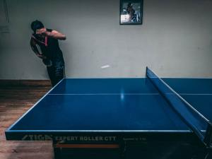 a dark blue ping pong table