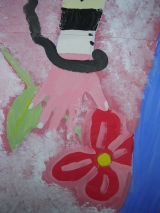 <h5>Mano con fiore (particolare)</h5><p>L'immagine è un dettaglio della silhouette della ragazza,  ottenuta attraverso la traccia del proprio corpo </p>