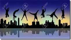 20669720-silhouettes-of-young-happy-people-jumping-a-big-city-panoramic-silhouette-by-night