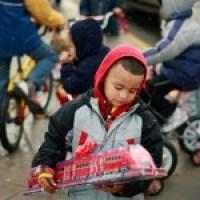 Boy holding toy train
