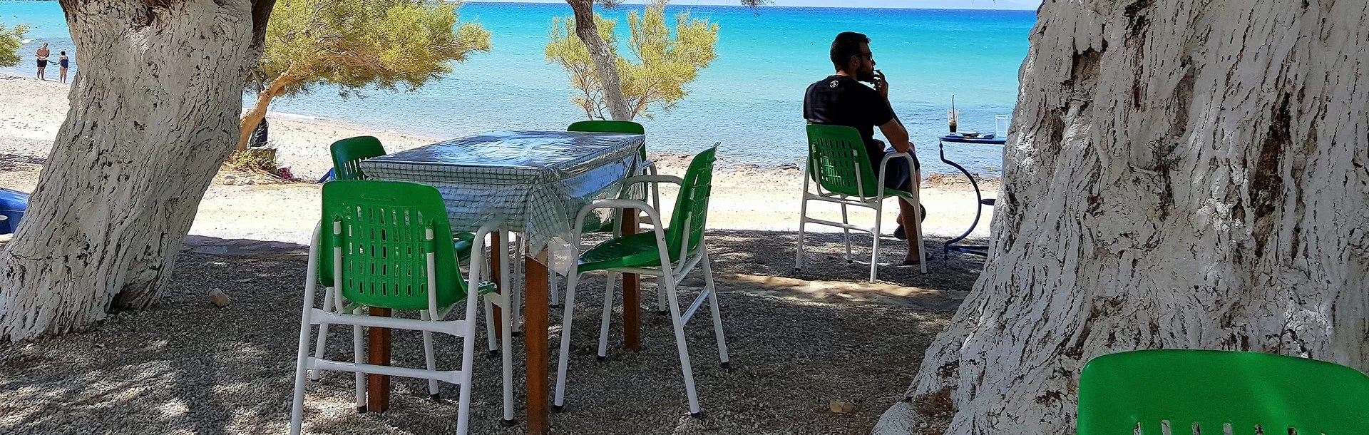 Naxos man sitting by beach