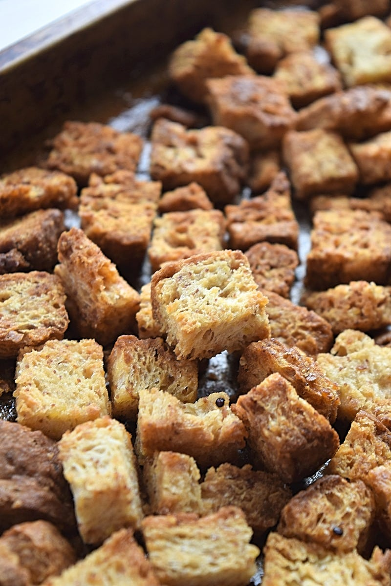Easy Gluten free Croutons should be a staple in every gluten free kitchen. Snack on them, toss them in salads and top soups with them. You can even make gluten free stuffing with them! Recipe from A Stray Kitchen