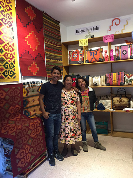 Omar Chavez with his mother Dolores and sister Janet in their shop, Galerie Re y Lola in Oaxaca Centro.