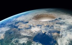 Algunos conspiranoicos creen que en La Tierra (y todos los planetas y satélites del Sistema Solar) hay agujeros en los polos para acceder al interior. Crédito: Hitandrun