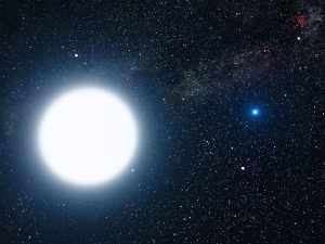 En esta recreación artística puedes ver Sirio A y B (a este sistema estelar lo conocemos, simplemente, como Sirio). Sirio B, la pequeña estrella a la derecha, es una enana blanca. Crédito: NASA, ESA y G. Bacon (STScI)