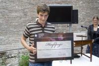 de 18-jarige Dejan Gajic, winnaar van de Nederlandse sterrenkunde Olympiade