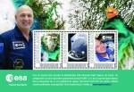 Missie André Kuipers brengt unieke postzegelset en collectie postkaarten