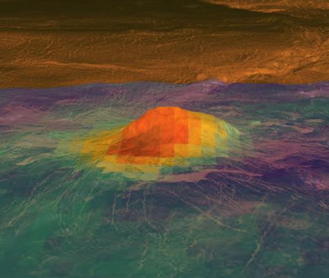 La imagen muestra una de las mejores evidencias de vulcanismo activo detectadas por la Venus Express. Se trata del pico volcánico de Idunn Mons, con un diámetro de alrededor de 200 kilómetros y situado en el área de Imdr Regio, en el hemisferio sur de Venus. La información topográfica fue derivada de los datos obtenidos por la sonda Magallanes de la NASA, con un factor de exageración vertical de 30x. Las observaciones de radar de la Magallanes (en color marrón) fueron superpuestas a sus datos topográficos. Las áreas brillantes son escarpadas o tienen pendientes pronunciadas, mientras que las zonas oscuras son llanas. Los datos superpuestos en colores muestran los patrones de temperatura derivados a partir de los datos de brillo de la superficie, y fueron obtenidos por el instrumento VIRTIS. Las variaciones térmicas debidas a la topografía fueron eliminadas. El rojo/naranja muestra las áreas más calientes y el púrpura las más frías. Puede notarse que el área a mayor temperatura está centrada en la cima del volcán, que se eleva unos 2.500 metros por encima de las planicies que lo rodean. Además, el brillo indica la composición de los minerales que fueron modificados por el flujo de lava, cuyo origen también coincide con la cima del volcán. Créditos: NASA / JPL-Caltech / ESA.