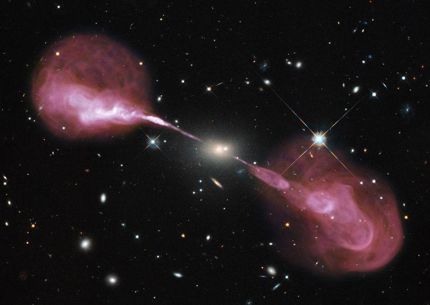 Os jactos relativísticos da galáxia activa Hercules A, observados em ondas de rádio (rosa), sobrepostos a uma imagem no visível obtida pelo telescópio Hubble. Os jactos estendem-se por mais de 1 milhão de anos-luz. Crédito: NASA, ESA, S. Baum e C. O'Dea (RIT), R. Perley and W. Cotton (NRAO/AUI/NSF) e Hubble Heritage Team (STScI/AURA).