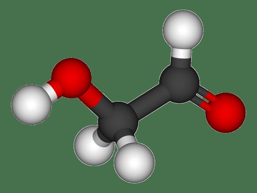 A molécula do glicoaldeído, um açucar simples. As esferas representam os átomos e os segmentos as ligações electrónicas entre os mesmos. As cores identificam o tipo de átomo: hidrogénio (cinza), carbono (preto) e oxigénio (vermelho). Crédito: Wikipedia.