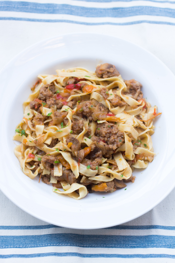 Drunken Italian Sausage and Pepper Noodles: White wine tomato sauce with caramelized bell peppers and onions, sautéed mushrooms and sweet italian sausage.