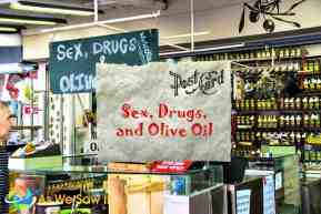An olive oil market displays its wares with a sign that says Sex, Drugs and Olive Oil