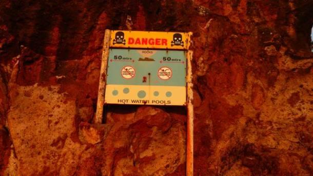 Danger Sign On Hot Water Beach, New Zealand