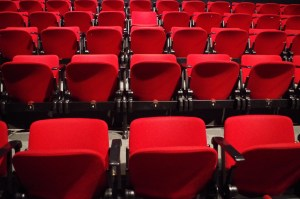 [Behind the Scenes Interview with Esther M. Hermida - image of red seats in a theater]