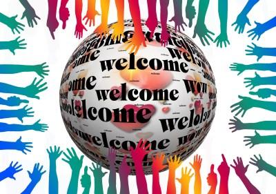 "[Language Access Services - ""welcome"" and many hands]"