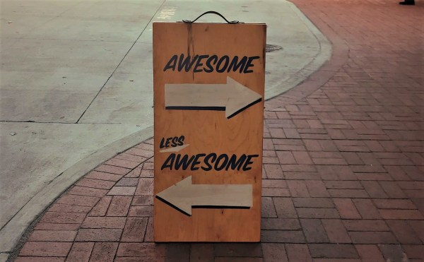 "Sign with directional arrows to ""awesome"" and ""less awesome"""