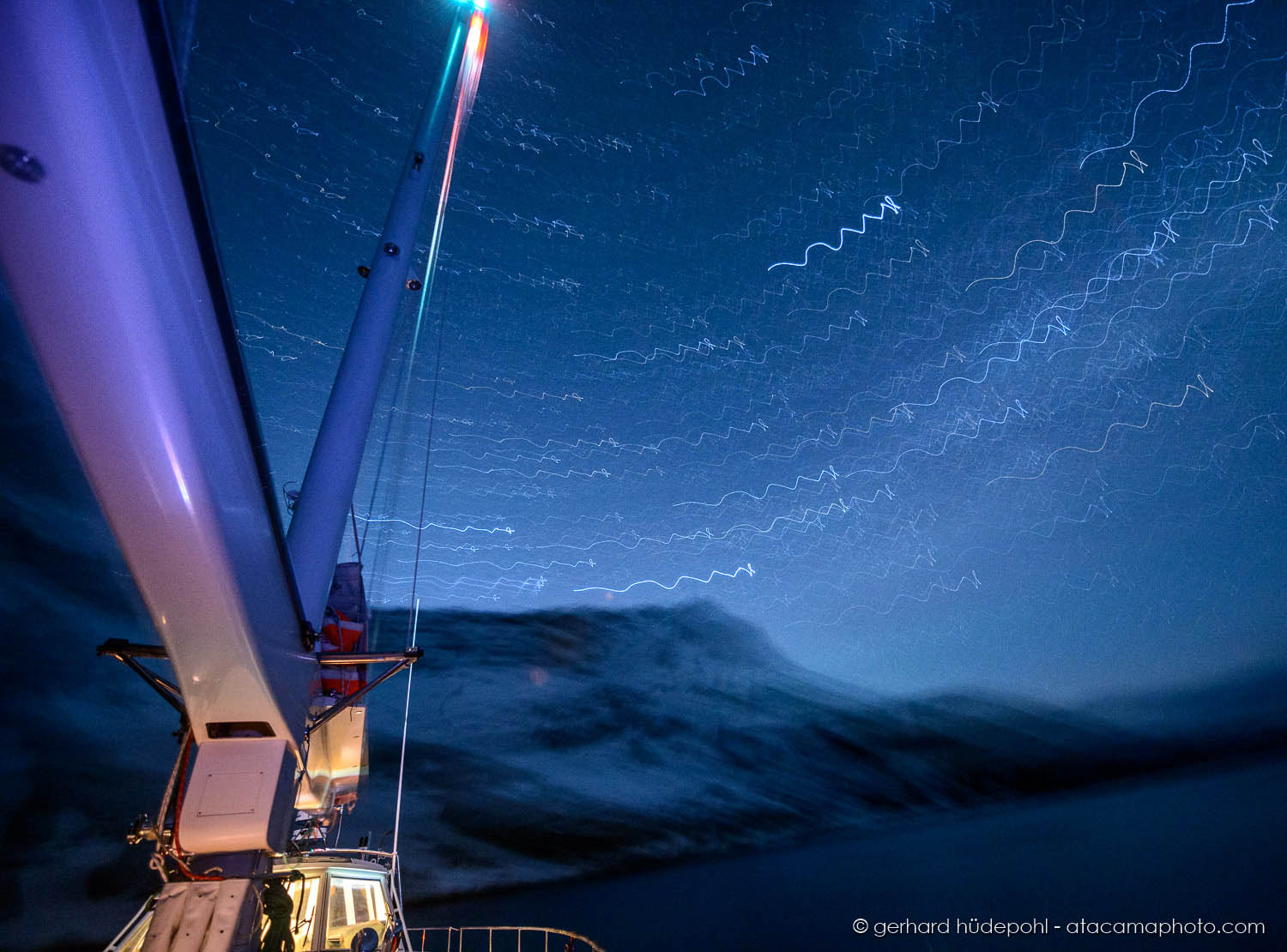Long exposure from an anchoring yacht at night at South Georgia Island. The rocking and rotating of the boat produces the lines of stars.
