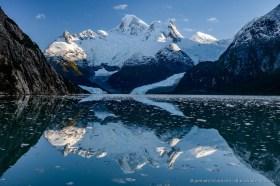 Cordillera de Darwin and Pia glacier reflecting in the water of Pia Fjord