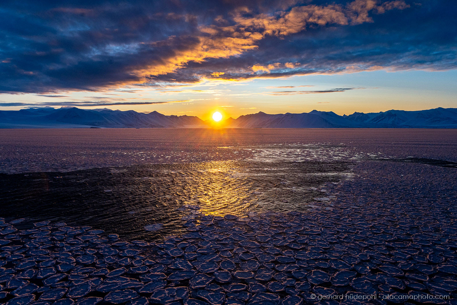 Antarctic ocean covered with pancake ice at sunset, McMurdo Sound