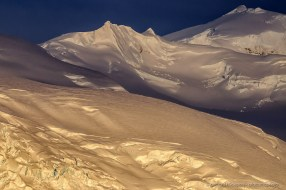 Magic orange evening light on snow and ice covered mountains in Antarctica