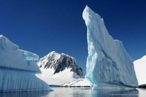 Spectacular iceberg and mountains near Port Lockroy, Antarctic Peninsula