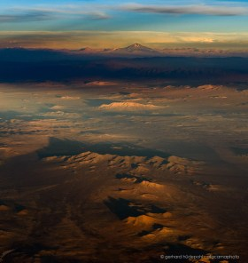 Dramatic aerial photo of the Atacama Desert in evening light with Llullaillaco volcano
