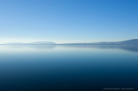 Morning haze at Villarica Lake, blue water, blue sky