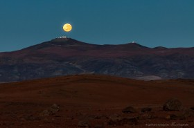 Full moon setting behind Cerro Paranal and the VLT Observatory
