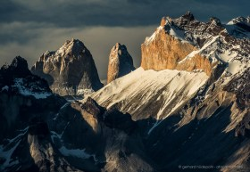 Vertical rock faces of Torres del Paine in dramatic evening light