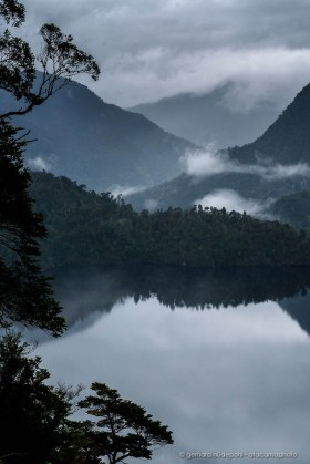 Fog, clouds and reflections. A rainy day in Alerce Andino National Park. Lake Sargazo.