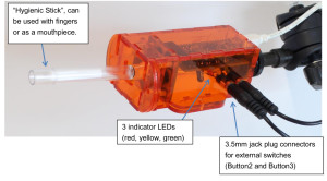 """Labeled photo of Flipmouse: """"Hygienic Stick"""", can be used with fingers or as a mouthpiece. 3 indicator LEDs (red, yellow, green) 3.5mm jack plug connectors for external switches (Button2 and Button3)"""