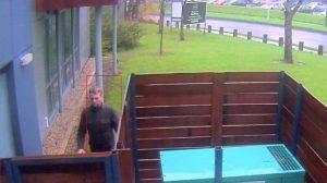 Man approaching house