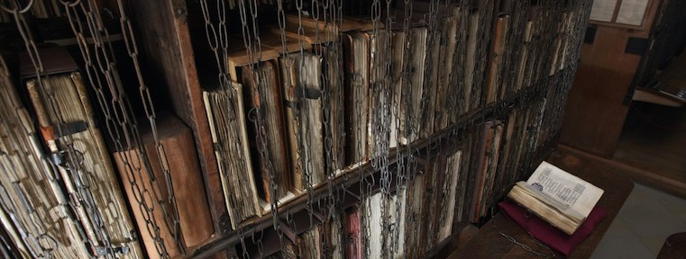 rows of locked old books. game of thrones