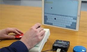 person using a joystick mouse to control an iPad