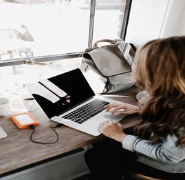 Girl on laptop sitting at desk