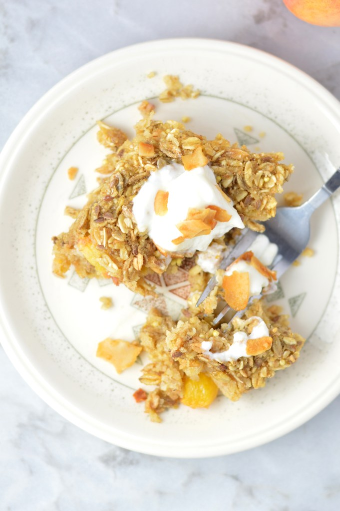 This Ginger Peach Baked Oatmeal is the perfect recipe idea for breakfast. Ready in 30 minutes. Best when topped with yogurt and coconut chips.