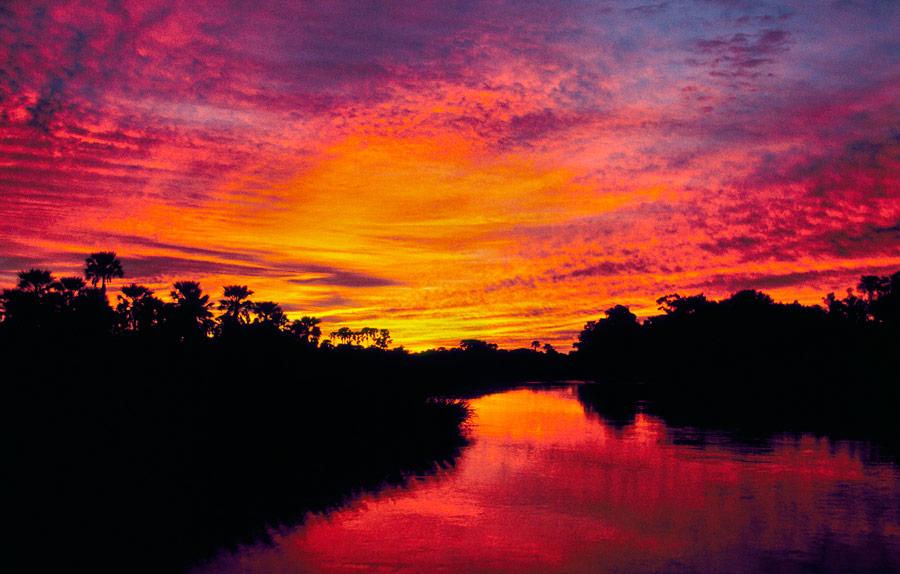 Botswana! Sunsets are a daily highlight on your Botswana Luxury Safari