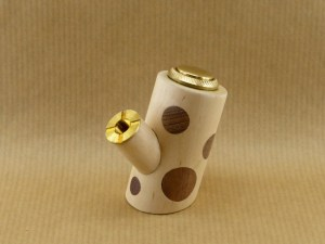 E-pipe with ash and walnut polka dots in close-up