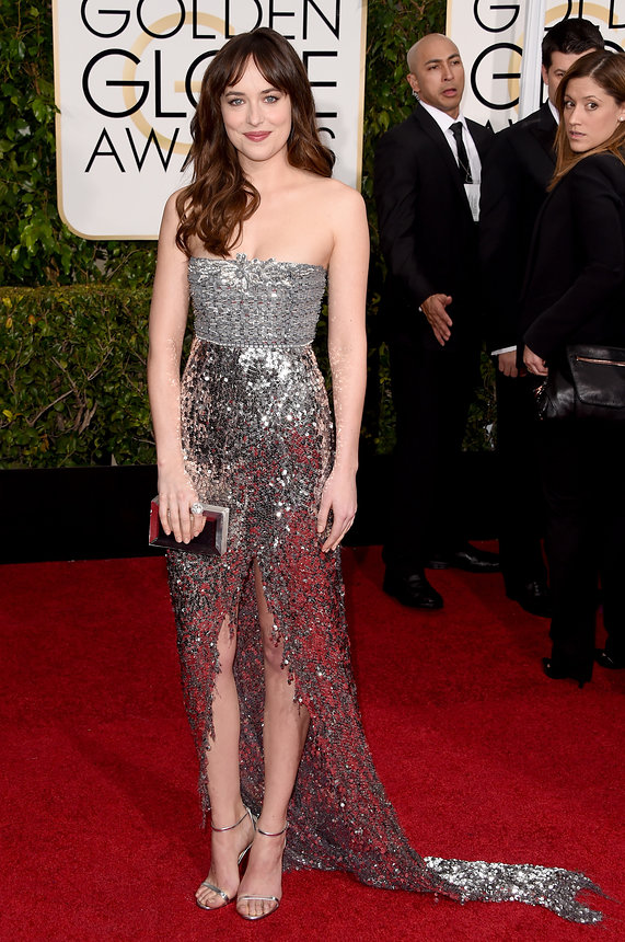 Dakota Johnson in Chanel Haute Couture and a Rauwolf bag