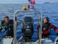smiling tec divers coming up the rib from parallel stairs