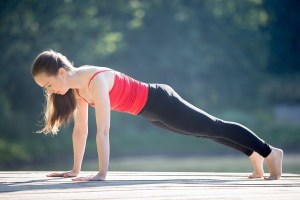 Teenage girl in plank pose
