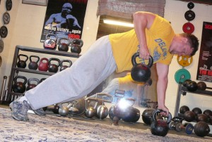 One way to get more motivated about fitness is to make it more fun by trying new exercises, such as lifting kettlebells like AHF writer Aaron Dorksen is pictured doing.