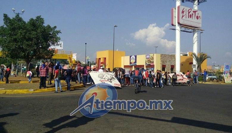 Elementos del GOES de la SSP de Michoacán ya se dirigen a la Calzada La Huerta para controlar la situación (FOTO: ARCHIVO)