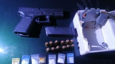 pistola asegurada, drogas